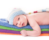 Baby on towels Stock Photos