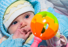 Baby and toy Stock Photos