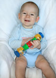 Baby with toy. The kid of 7 months sits with toy Stock Images