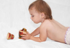 The baby and toy Stock Photos
