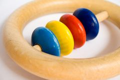 Baby Toy. A small wooden toy with moving ring, made for very small babies stock image