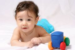 Baby toy. Baby playing with colored car Royalty Free Stock Photo