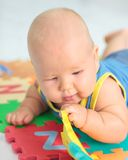 Baby with toy Stock Image
