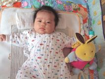 Baby and toy Stock Images