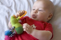 Baby with toy. Photo Royalty Free Stock Photos