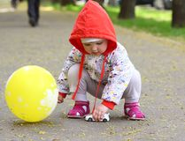Baby with the toy and baloon Royalty Free Stock Photo