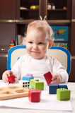 Baby with toy blocks Stock Photos