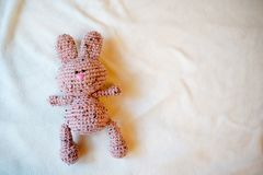 Baby toy bunny, childhood background with empty place for text. copy space. Baby toy bunny, light childhood background with empty place for text. copy space stock photography