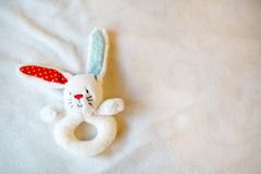 Baby toy bunny, light childhood background with place for text. copy space. top view. Baby toy bunny, light childhood background with empty place for text. copy royalty free stock photo