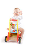 Baby on toy car. On white Royalty Free Stock Photography