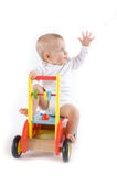 Baby on toy car Royalty Free Stock Image