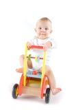 Baby on toy car. (studio shot Stock Photo