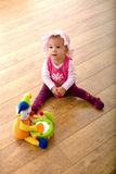 Baby and toy clown Royalty Free Stock Photo