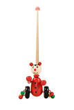 Baby toy clown on wheels. Red wooden toy clown on wheels with a stick and balls for little kids isolated on white background Royalty Free Stock Photos
