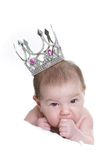 Baby in toy crown over white Royalty Free Stock Photo