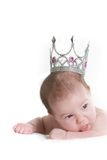 Baby in toy crown over white Royalty Free Stock Photos