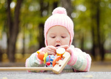 Baby with a toy Stock Images