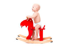 Baby on the toy horse or elk Stock Image