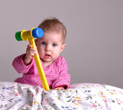 Baby with a toy hummer Stock Image