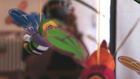 Baby toy newborn children background hanging rattle musical crib closeup butterflies.  stock footage
