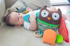 Baby with toy owl Royalty Free Stock Image