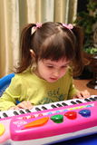 Baby and toy piano Stock Photography