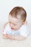 Baby with toy rabbit. Baby age of 8 months plays with toy rabbit Royalty Free Stock Images