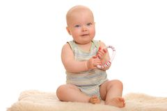 Baby with toy ring Royalty Free Stock Image