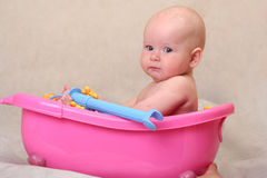 Baby in toy's bath Royalty Free Stock Image