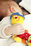 Baby with  a toy Stock Image