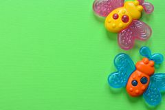 Baby toy teether background, copy space.  stock photos