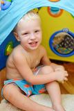 Baby in toy tent Stock Images