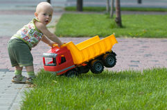 Baby with toy truck Stock Photo