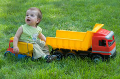 Baby with toy trucks Royalty Free Stock Image