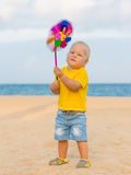 Baby with toy windmill Stock Image