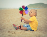 Baby with toy windmill Stock Photography