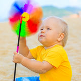 Baby with toy windmill Royalty Free Stock Photos