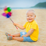 Baby with toy windmill Royalty Free Stock Images