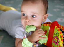 Baby with toys. Portrait of a baby with toys Royalty Free Stock Photography