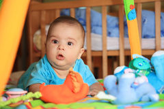 Baby and toys. Little baby playing with toys Stock Image