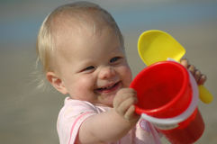 Baby with toys stock photography