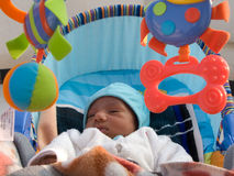 Baby with toys. Photo of a baby surrounded with colorful toys Stock Images