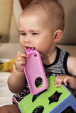 Baby and toys. Cute little baby playing with colorful toys at home Royalty Free Stock Photo