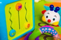 Baby toys laying on a mattress Stock Photo