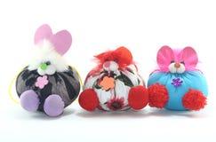 Baby toys. Nature ornamental plants  ornamental  beautiful little white  pink box  dreams three dolls Stock Photos