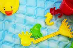 Baby toys at poolside Royalty Free Stock Photo