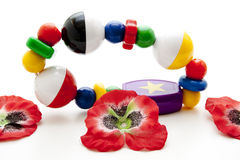 Baby toys with red blossoms Royalty Free Stock Photography