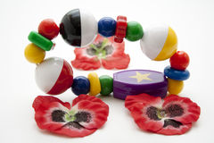 Baby toys with red blossoms Royalty Free Stock Images