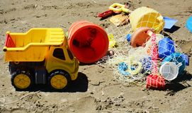 Baby toys on sand, on the beach Royalty Free Stock Photography