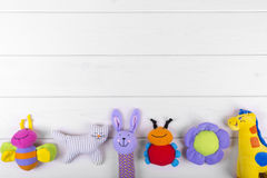 Baby toys on wooden background with copy space. Stuffed baby toys on wooden background with copy space stock photography